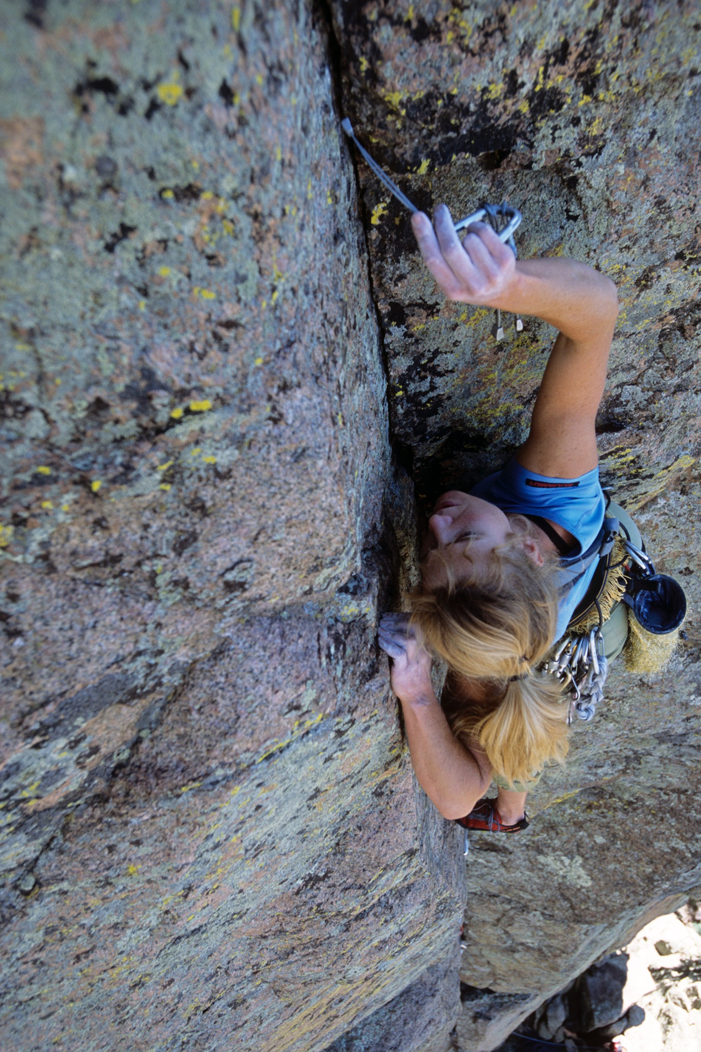 Cranking hard and feeling good! Carolyn Parker sewing up Rawhide (5.10+), Sandia Mountain Wilderness, NM. ©Kennan Harvey