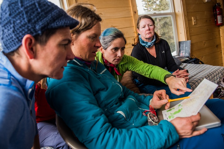 Karen Bockel teaches Chicks Skiing Backcountry Hut trip participants about the avalanche forecast, avalanche problems types and terrain maps before going skiing
