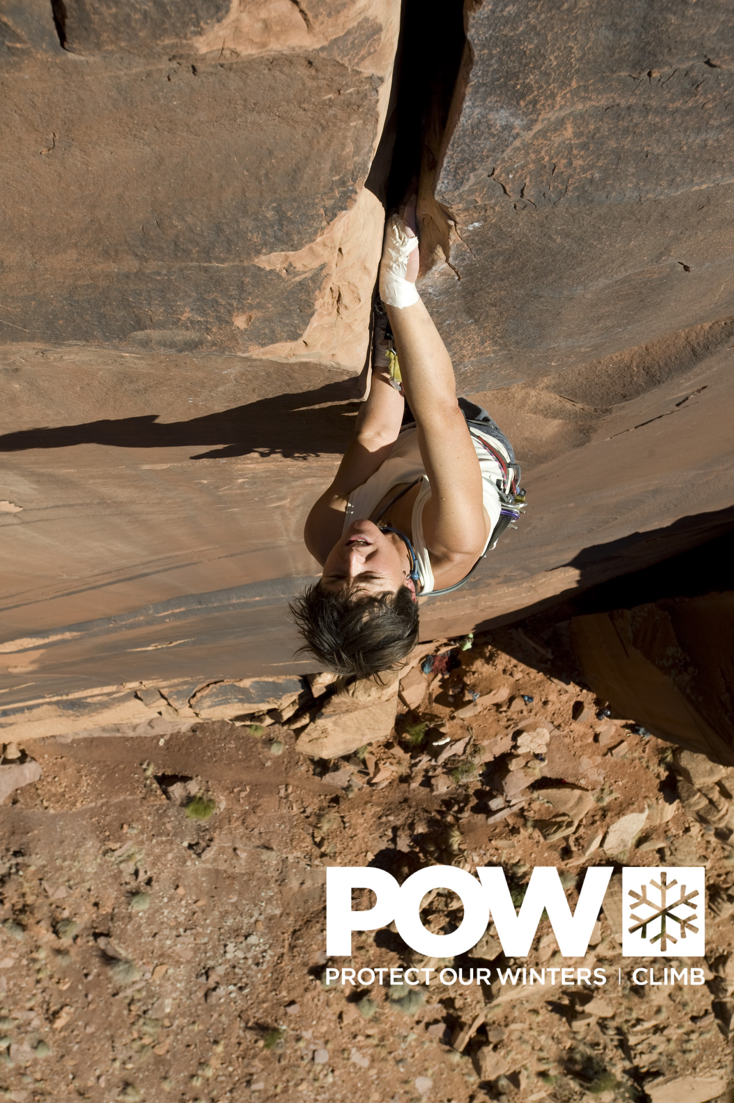 POW poster of Angela Hawse climbing a 5.10 crack climb in Indian Creek, utah