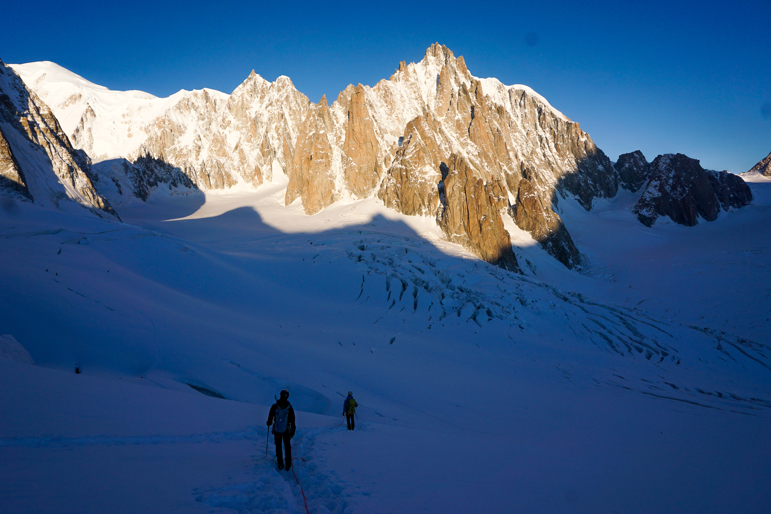 fun in the present moment watching sun-shadow line on approach to chandelle du tacul, chamonix, france